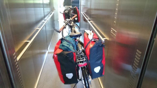 Everyday crosser with bags in the elevator